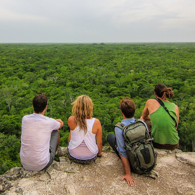 Overlooking the Mexican jungle on top a temple in Cobá with @funforlouis @vagabrothers #travelvloggers #tbexcancun