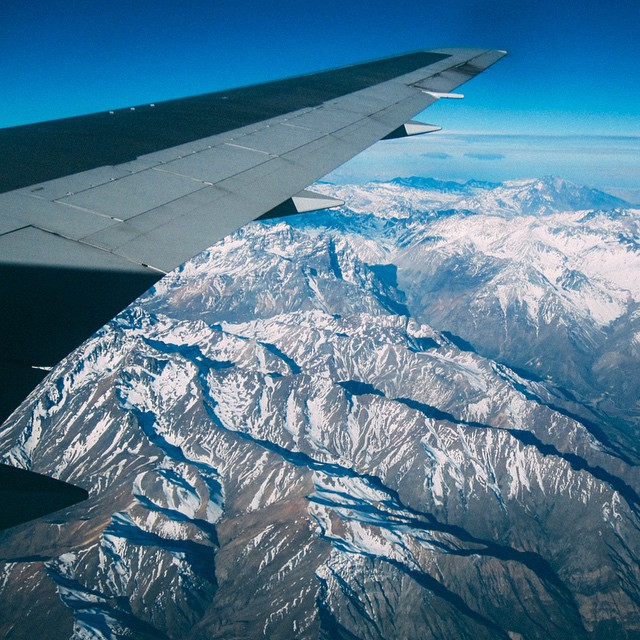 One of my favourite travel pictures. Flying over the Chilean Alps. ✈️? Tag someone YOU want to take on an adventure with! ?